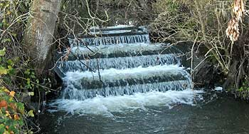 Ornamental weir structure on the Plumpton Mill Stream